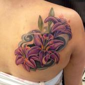 Purple lily shoulder piece, love the use of color in this